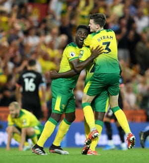 Norwich City's Alexander Tettey (left) and Sam Byram celebrate at the final whistle.