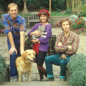 Simon Groom with Goldie, Janet Ellis with Jack and Peter Duncan with George in the Blue Peter garden in 1983.