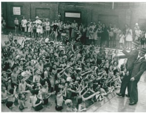 The then mayor, William Robert Wylie, tosses halfpennies into Bankstown pool in what was known as the halfpenny scramble. Circa 1933.