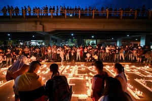 People gather for a vigil in Cali in honour of people who have died during the protests