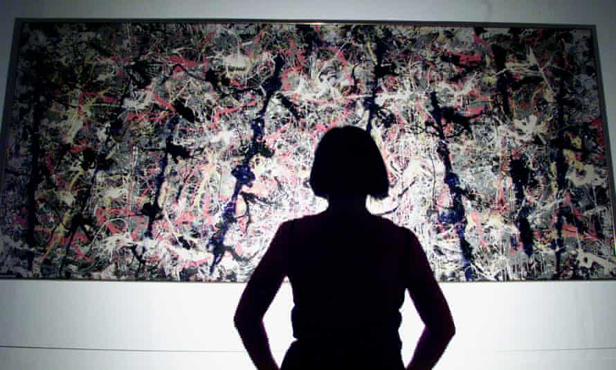 A visitor to the Tate looks at a Jackson Pollock painting