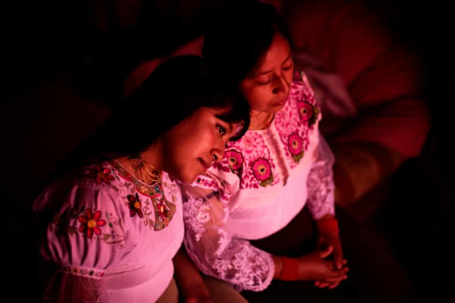 """Katerine Pupiales (20) and Marisol Pupiales (27), two communitarian teachers, poses for a portrait in their home. Marisol volunteers at San Clemente school, teaching """"kichwa"""" an indigenous native language"""