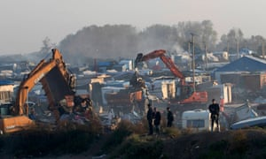 Bulldozers are used to tear down makeshift shelters and tents in the camp.