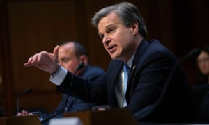 Christopher Wray testifies before a Senate committee.