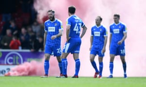 Notts County players look dejected after conceding in the defeat at Swindon