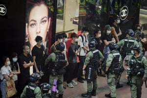 Hong Kong, China Police check pedestrians in Causeway Bay on National Day. The popular shopping district had a heavy police presence after people were urged via the internet to join protests