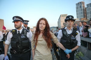 A member of the environmental campaign group Extinction Rebellion is arrested by police on Waterloo Bridge.
