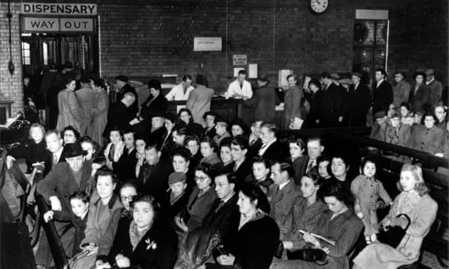 Outpatients wait to see the doctors at the London Hospital in 1949.