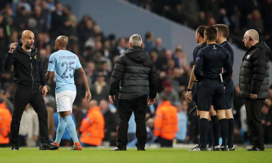 Pep Guardiola gestures towards the referee Antonio Mateu Lahoz at half-time during Manchester City's Champions League quarter-final against Liverpool