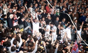 West Ham skipper Billy Bonds holds aloft the FA Cup to the delight of team mates and the Wembley crowd after The Hammers' 1-0 win over Arsenal.