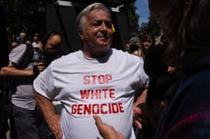 Man in a 'Stop White Genocide' T-shirt.