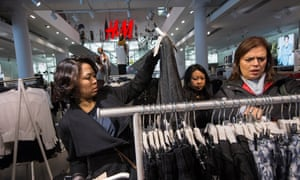 Shoppers look at clothes in H&M's Regent Street store