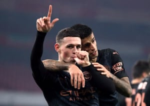 Manchester City's Phil Foden celebrates scoring his side's third goal of the game.