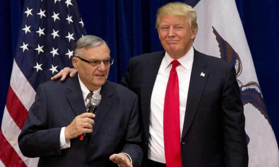 Joe Arpaio and Donald Trump together in Iowa. Trump called him an 'American patriot' after issuing the pardon.
