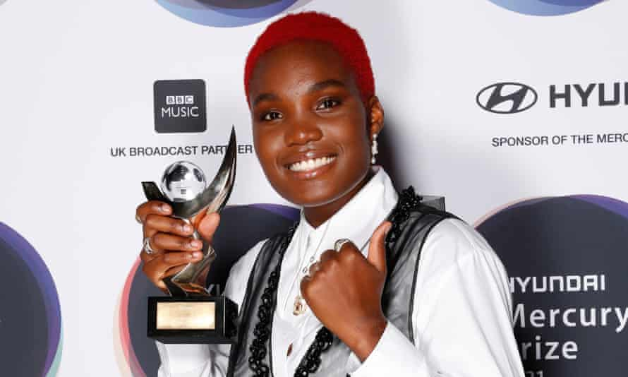Arlo Parks with her winning trophy at the Mercury prize ceremony.