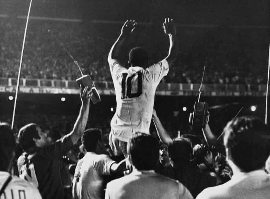 Pele is lifted by his Santos teammates after scoring the 1,000th goal of his career against Vasco da Gama at the Maracanã.