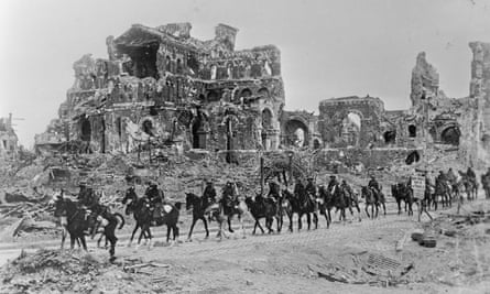 The British cavalry passing the remains of Albert Cathedral, after the second Battle of the Somme, August 1918.