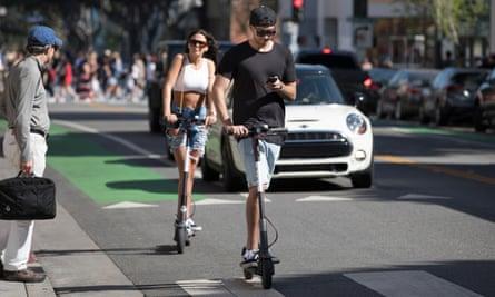 Bird electric scooter riders in Santa Monica, California.