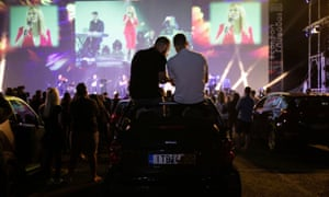 The Greek singer Natassa Theodoridou performs at a drive-in concert in the Athens suburb of Glyfada on 2 June.