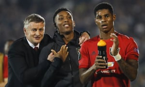 Ole Gunnar Solskjær with Anthony Martial, centre, and Marcus Rashford after Manchester United's win at Partizan Belgrade