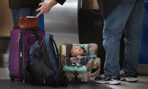 Child at airport with family
