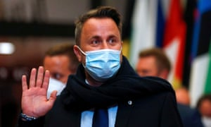 Luxembourg's Prime Minister Xavier Bettel waves at the end of the first day of a European Union leaders meeting in Brussels, Belgium, 25 June.