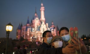 Visitors at Shanghai Disneyland where US attorney general William Barr says government officials are allowed a management role.