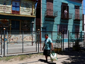 Gustavo Delgado, 52, who lost his job during the pandemic, walks towards a soup kitchen where he collects food every day for his family, in Buenos Aires. Argentine families are struggling against poverty as unemployment, inflation and the pandemic batter the economy.