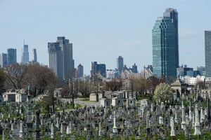 The New York city skyline pictured behind Calvary cemetery in Queens
