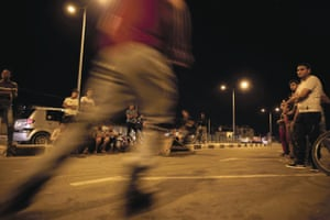 Young people display their skills on rollerblades and bicycles
