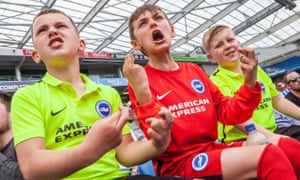 Young Brighton fans watch their team play Middlesbrough.