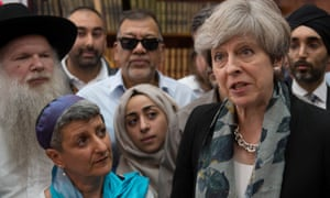 Britain's Prime Minister Theresa May speaks to faith leaders in Finsbury Park Mosque, near the scene of an attack, in London