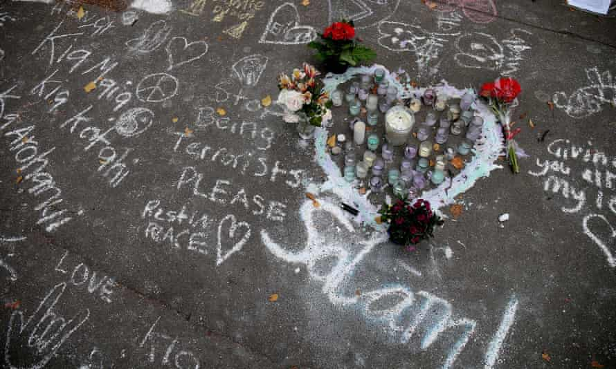 Messages written in chalk are seen on a pavement in Christchurch