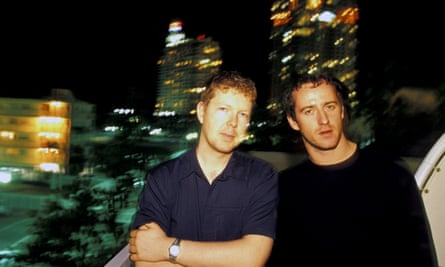 Jon Digweed and Sasha stand in front of Miami cityscape in 2000
