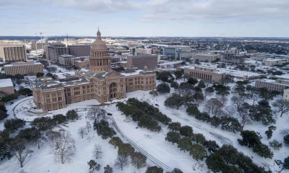 The Texas state capitol grounds in Austin covered in snow. Power issues in the state have endangered elderly, poor and disabled residents most.