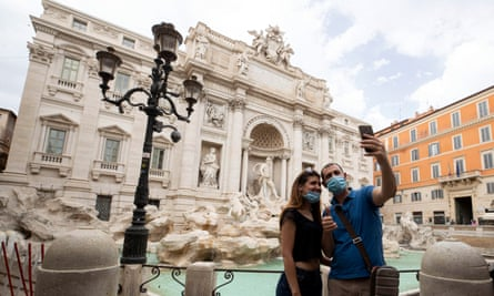 Tourists take a selfie in front of the Trevi Fountain, Rome, on Monday.