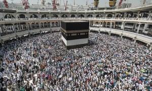 Muslim pilgrims circle the Ka'bah in the Muslim holy city of Mecca, Saudi Arabia.