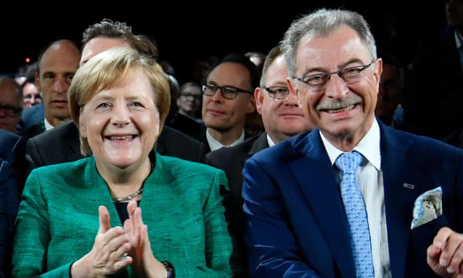 The German chancellor Angela Merkel and the head of the Federation of German Industries Dieter Kempf