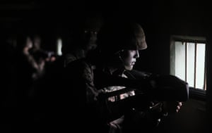 A marine watches over the coast during a drill in Baengnyeong near the western sea border with North Korea.