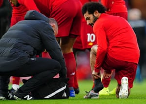 Mohamed Salah of Liverpool gets treatment in the warm.