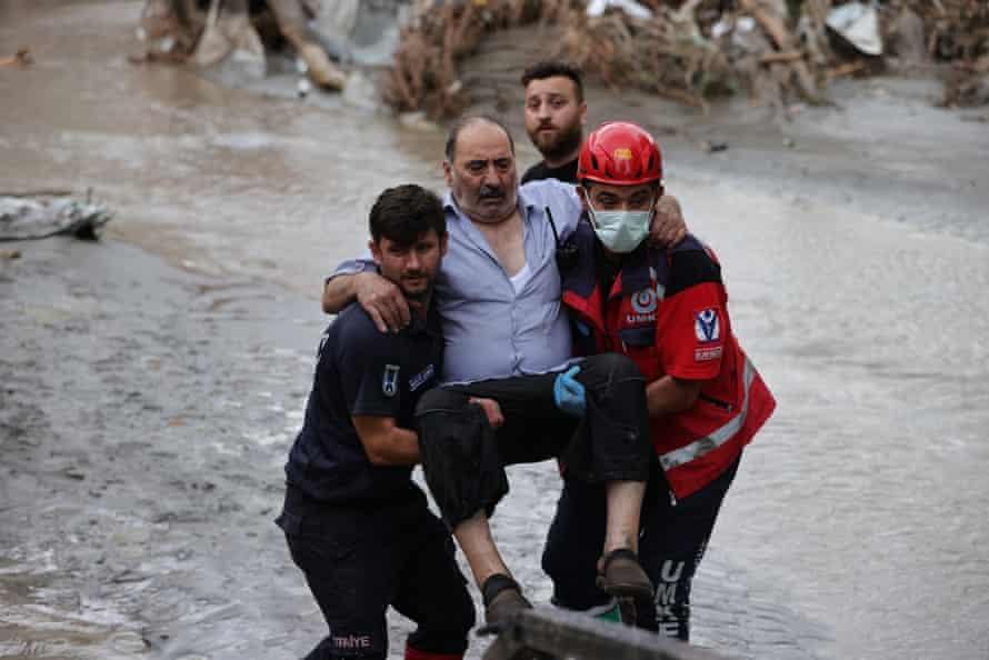 Rescuers evacuate am injured man in the Bozkurt district of Kastamonu, Turkey.