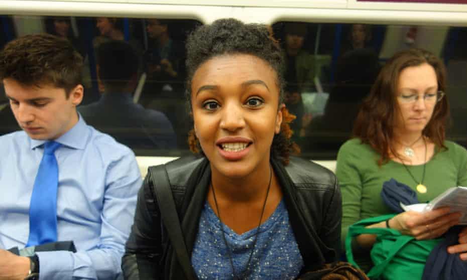 Girl on tube, London.