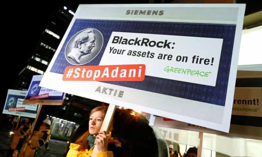 Greenpeace demonstrators protest in front of a BlackRock office in Frankfurt, Germany, in February 2020.