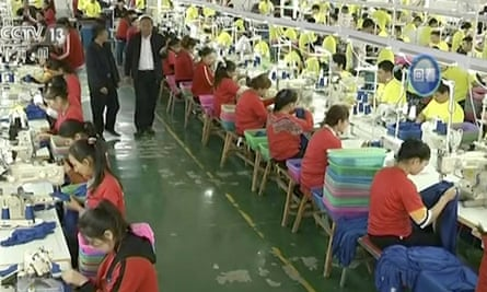 In this undated video footage run by China's CCTV, Muslim trainees work in a garment factory at the Hotan Vocational Education and Training Center in Hotan, Xinjiang.