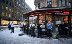 Restaurant owners and their staff protest against restrictions due to pandemic, outside a resturant in central Stockholm, on 14 January, 2021. Serving alcohol at restaurants after 8pm is not allowed until 25 January, and a maximum of four guests are allowed to sit together.