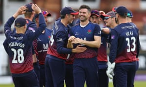 James Anderson is congratulated by his Lancashire teammates after taking the wicket of Nick Gubbins.