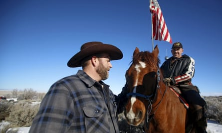 Militia leader Ammon Bundy, left, greets occupier Duane Ehmer and his horse Hellboy at the Malheur national wildlife refuge near Burns, Oregon, on Friday.