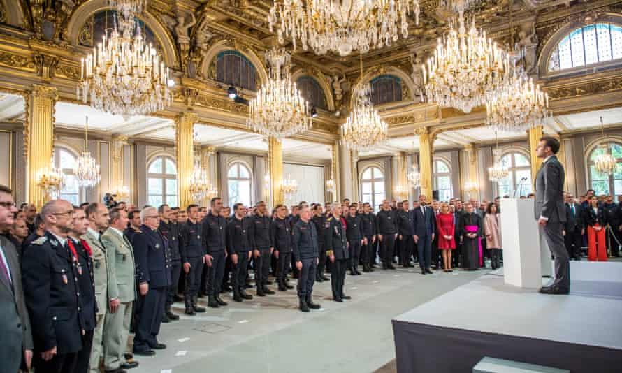 President Emmanuel Macron speaks to Parisian firefighters on Thursday.