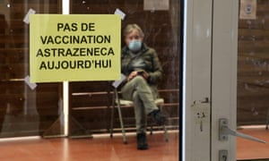 "A man waits in a vaccination center where a sign reads ""No AstraZeneca vaccinations today"" in Saint-Jean-de-Luz, southwestern France."