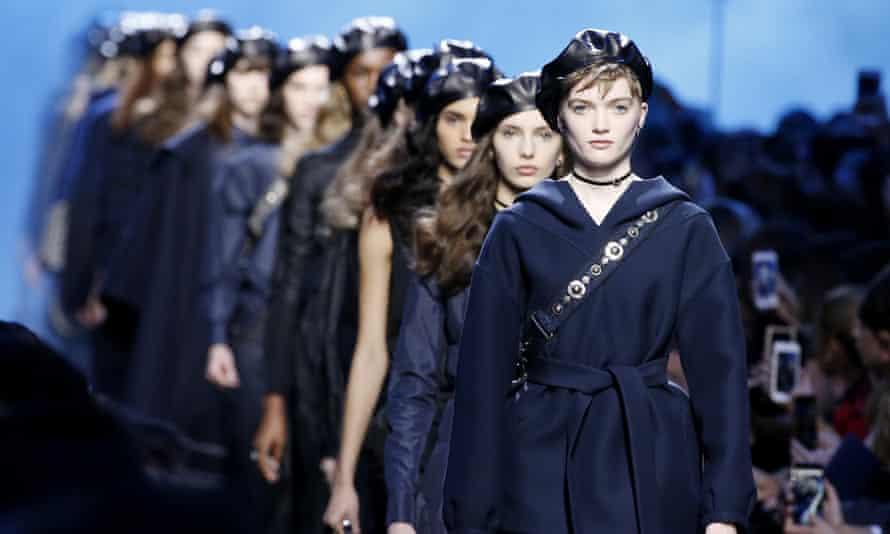 Models on the catwalk at a Christian Dior show at Paris Fashion Week 2017.